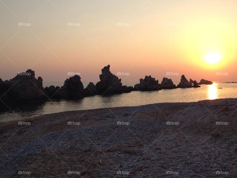 beach sunset sea rocks by zacharis81