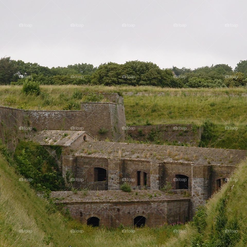 Part of the Dover Castle on a hill in England on a summer day.