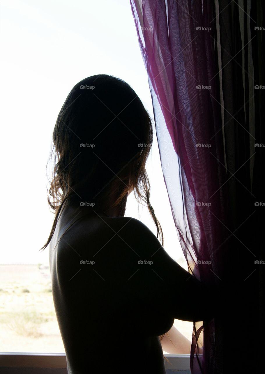 beautiful nude woman in the window