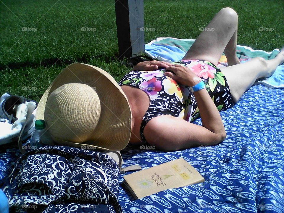 sunbathing.... my mom taking in the sun at the lake