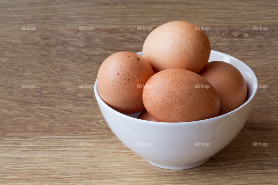 Close-up of brown eggs in bowl