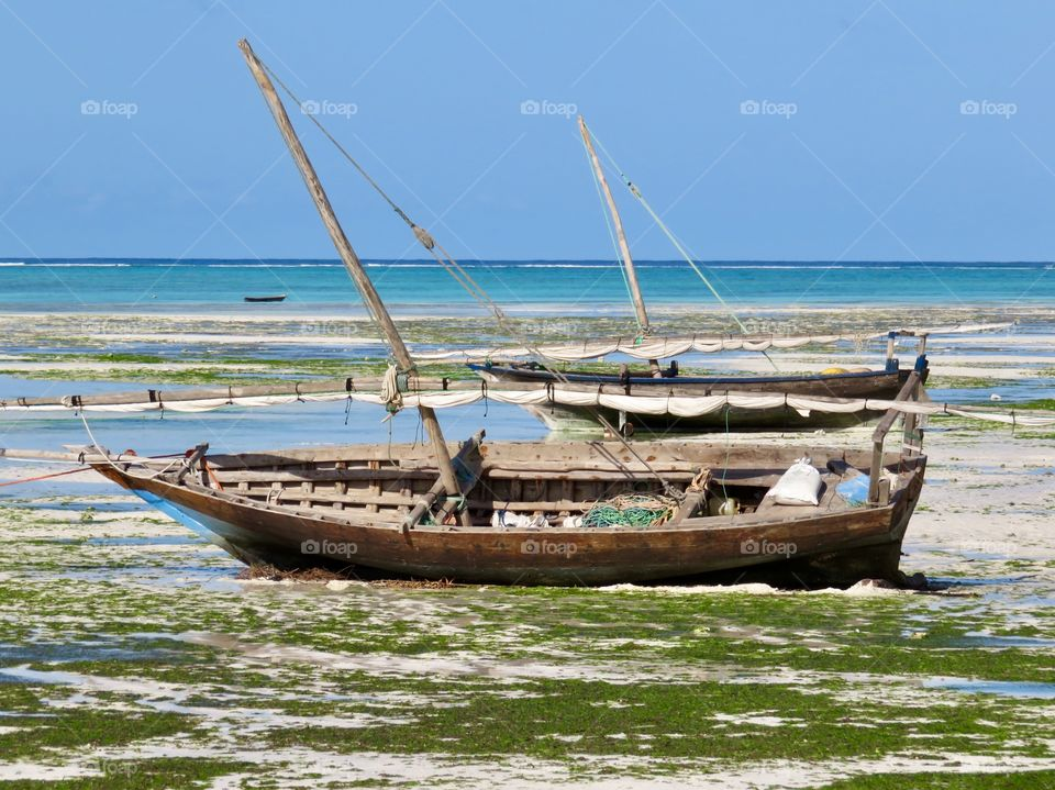 Wooden boat on a white sand beach