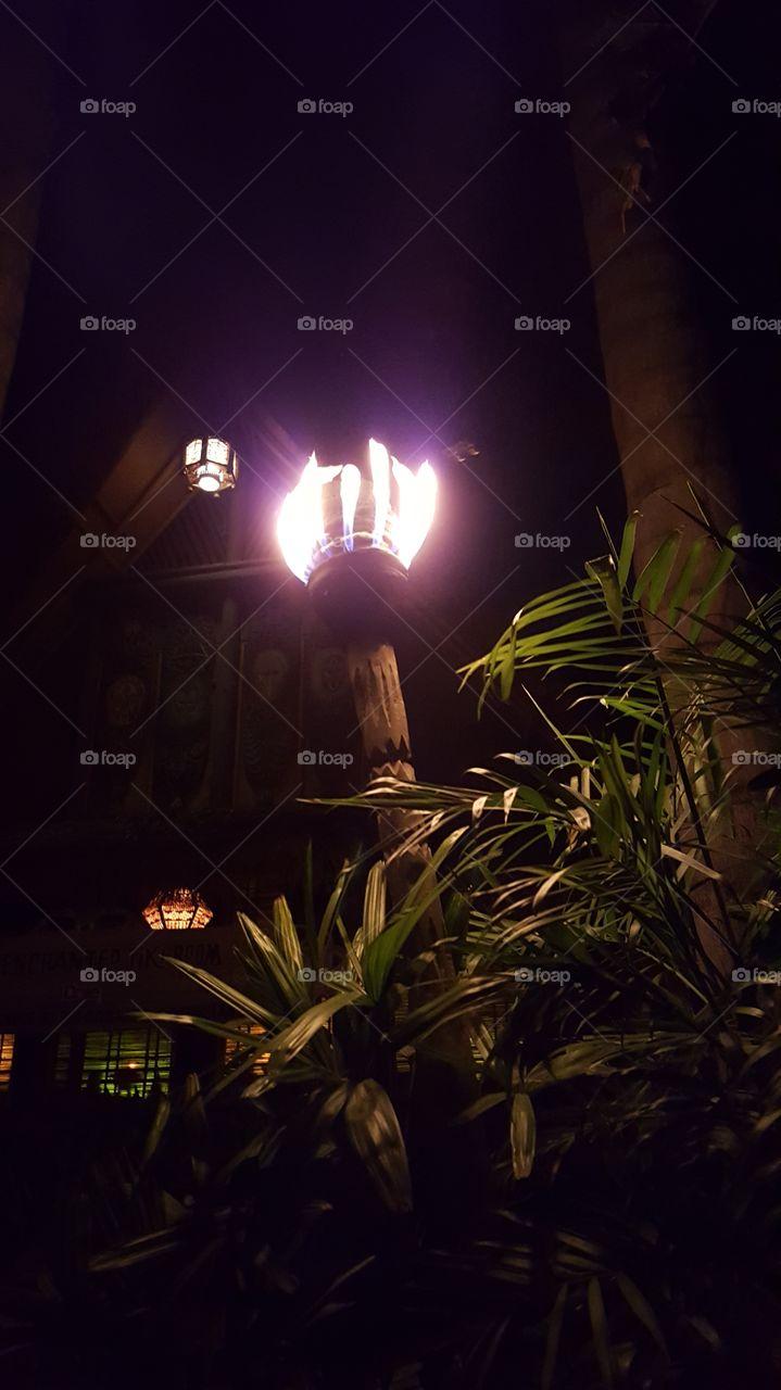 tiki torches outside of the Tiki Room at Disneyland