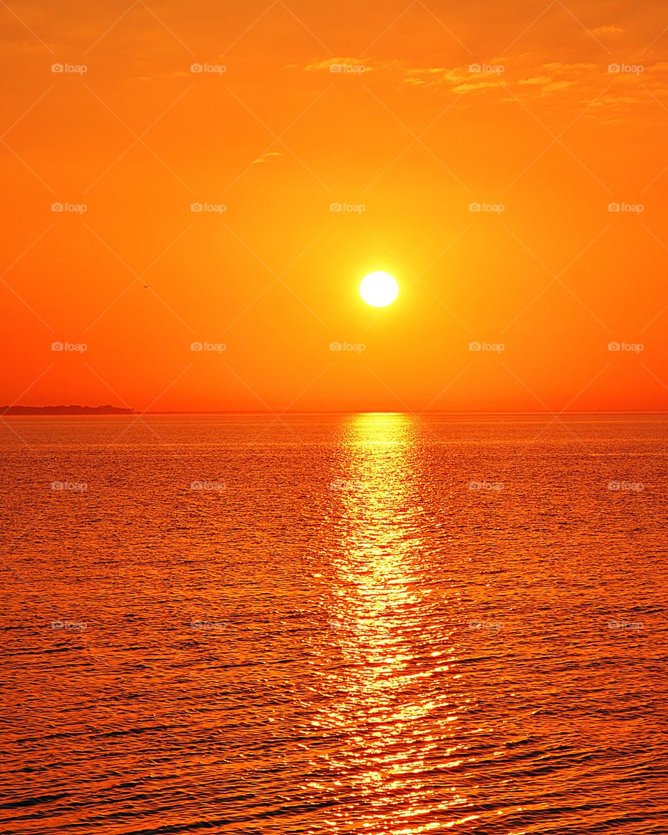 The orange color stories. The vast, magnificent orange sunset. Sinking beneath the horizon, the threads of light lingered in the sky, mingling with the rolling clouds, dyeing the heavens bright orange.