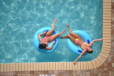 Two young ladies enjoying a relaxing day in the pool.