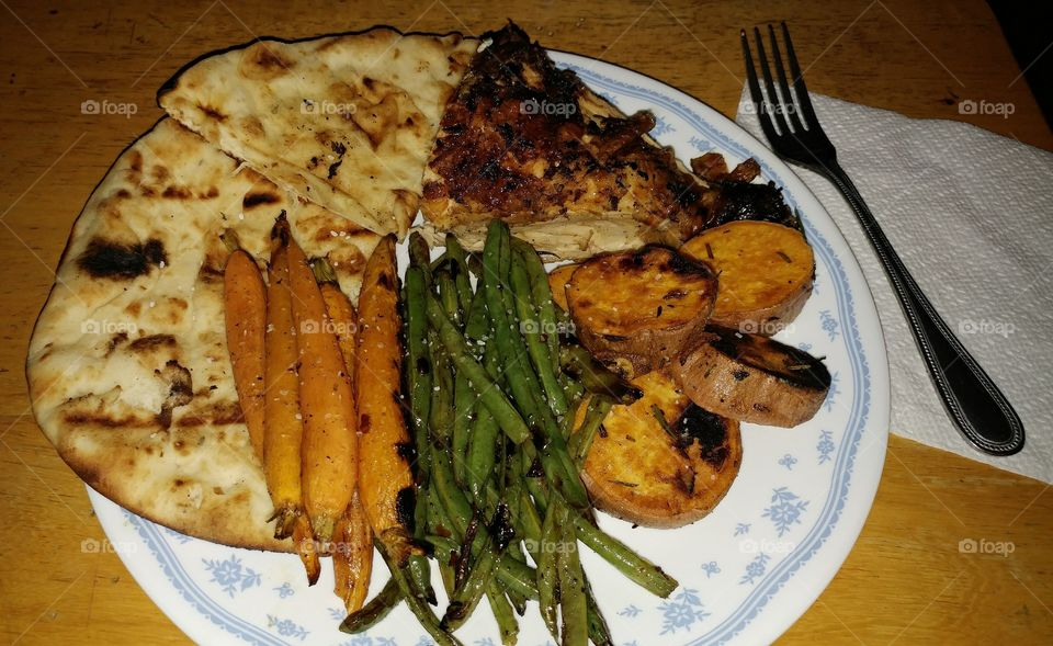 Grilled Lemon & Rosemary Chicken with Grilled Sweet Potato Medallions, Spicy Grilled String Beans and Baby Carrots, and Grilled Garlic Flat Bread