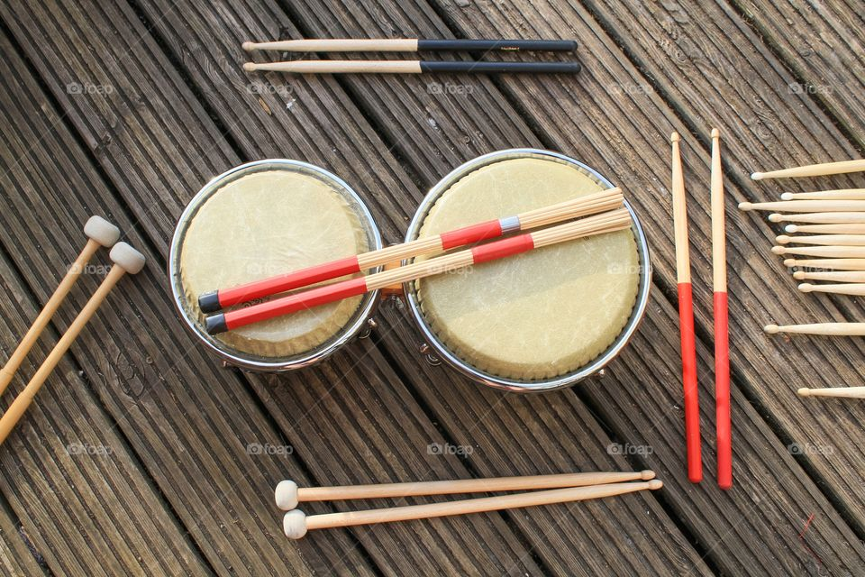 Various drumsticks on a set of bongos