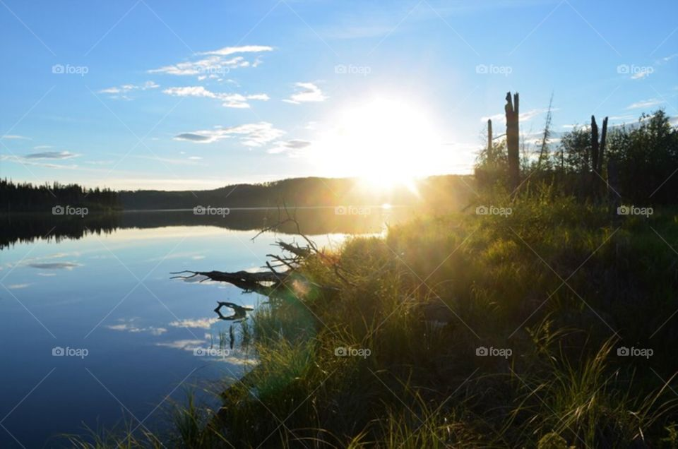 Sunbeams shining bright at our perfectly serene fishing hole in Northern Alberta. Every night after work during the summer we would hike down to the water and try our luck. I love the mirror effect of the perfectly calm water.