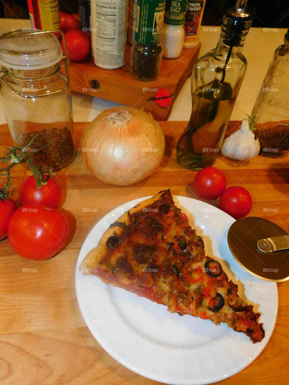 Delicious and nutritious homemade pizza with fresh, colorful vegetables, meats and a variety of spices! Grab a slice!