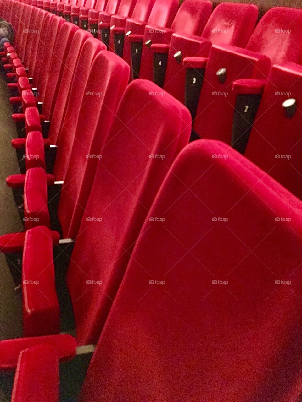 Red chairs in opera house
