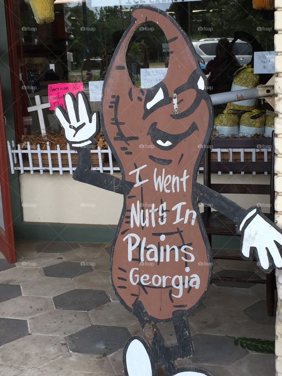 Georgia peanut sign in the city of Plains, Georgia outside of a novelty store with Plains peanut icecream and fudge inside.