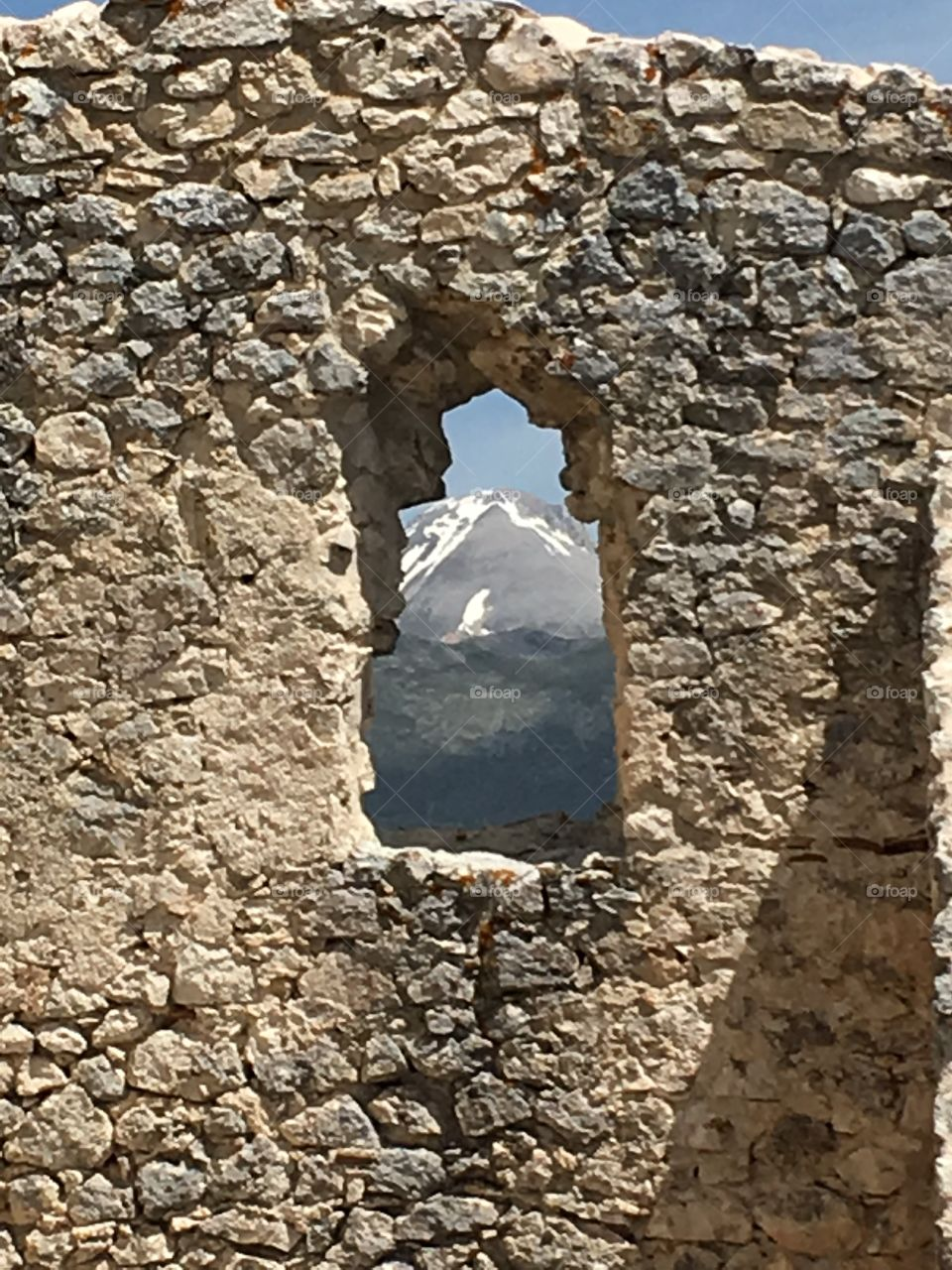 View through a window of the mountains