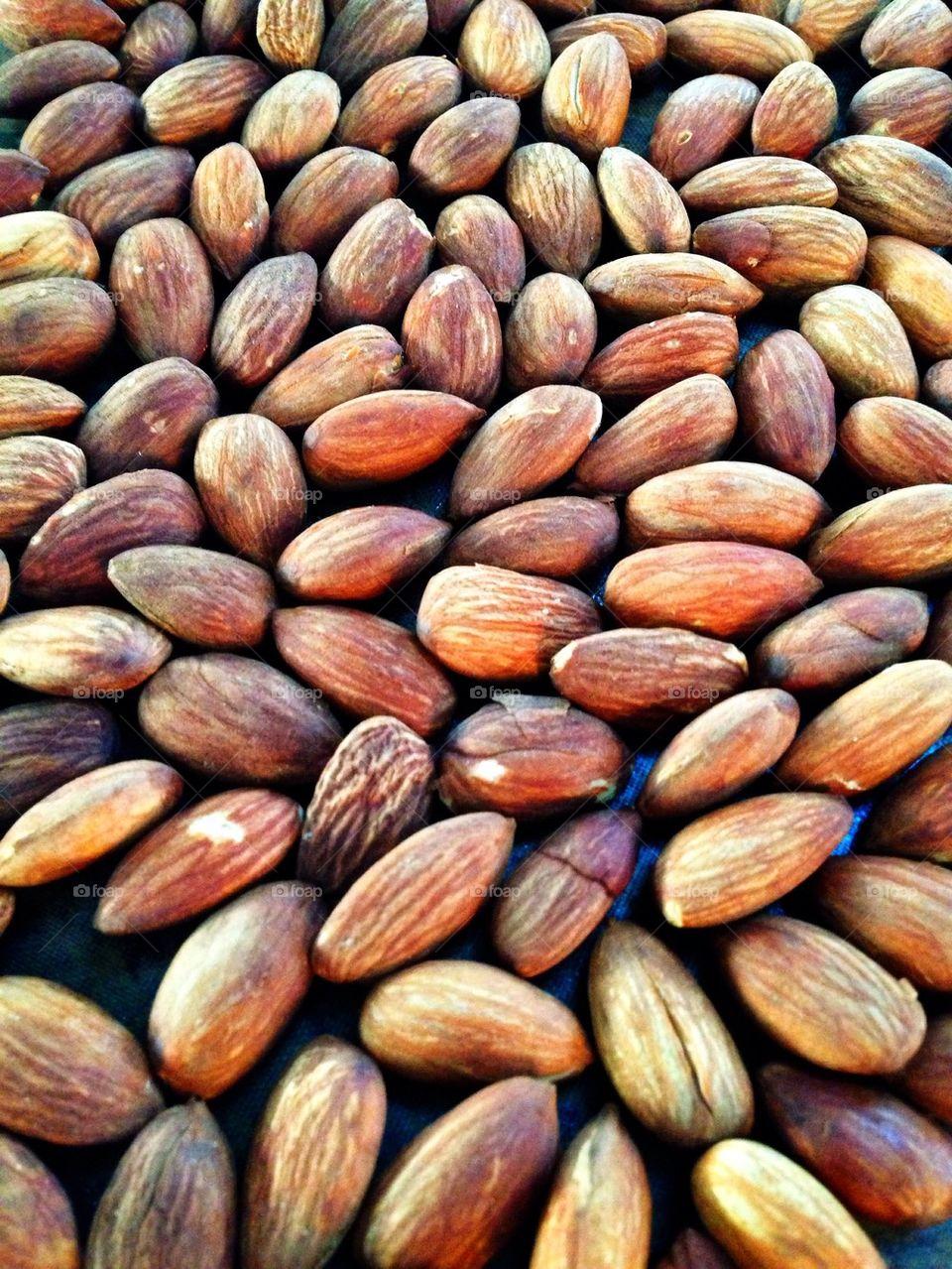 Full frame of roasted almonds