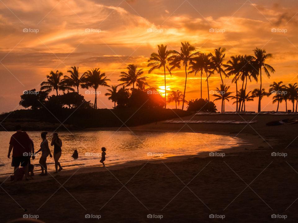 Hawaiian tropical sunset. Ko'olina beach lagoon sunset Hawaii Oahu island with family in the shoot