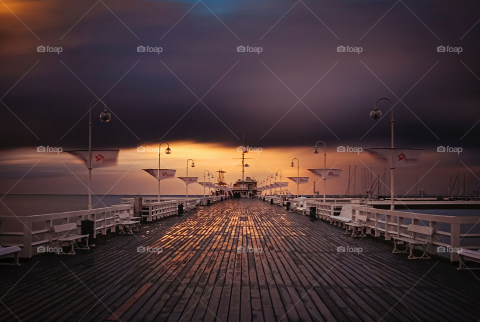 Fantastic pier in Sopot after the storm at sunset