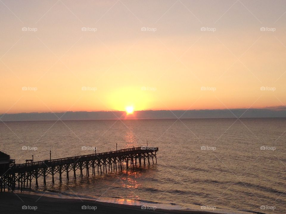 Myrtle memories. Myrtle Beach sunrise after the rains the caused lots of damage