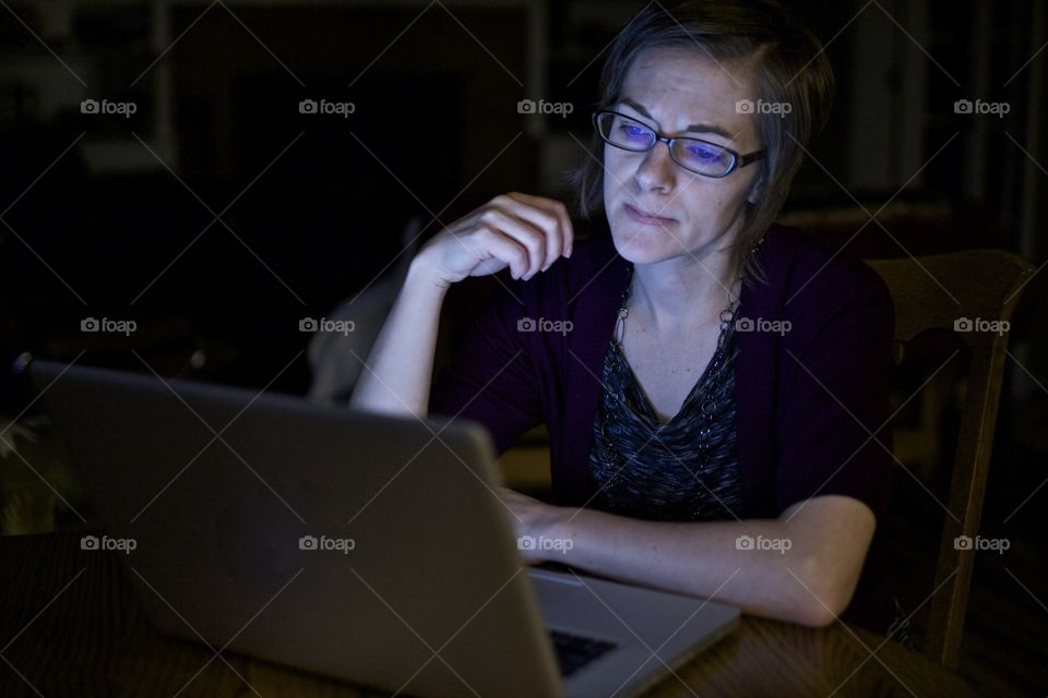 Woman angry at laptop computer. Technology getting a woman down