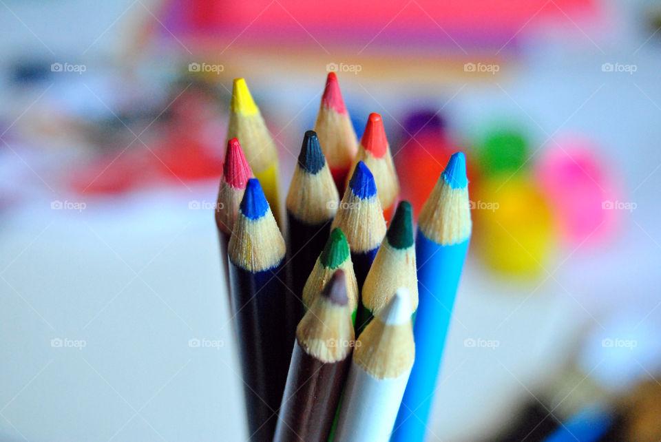Art supplies, colored pencils, paintbrushes, paint, sketch book, watercolor pad, palette