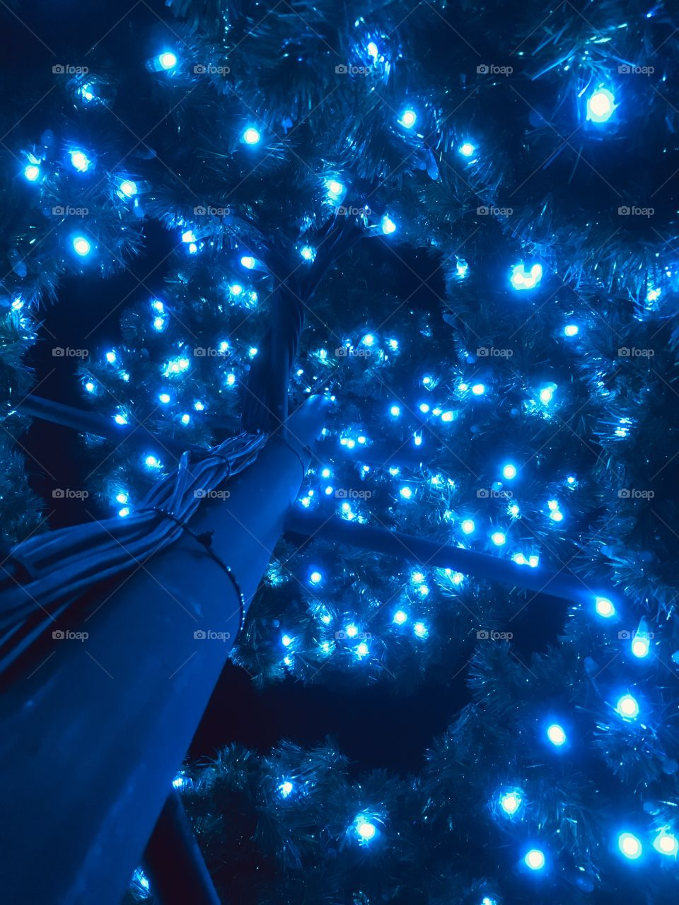 Spiraling blue Christmas lights from underneath 🎄