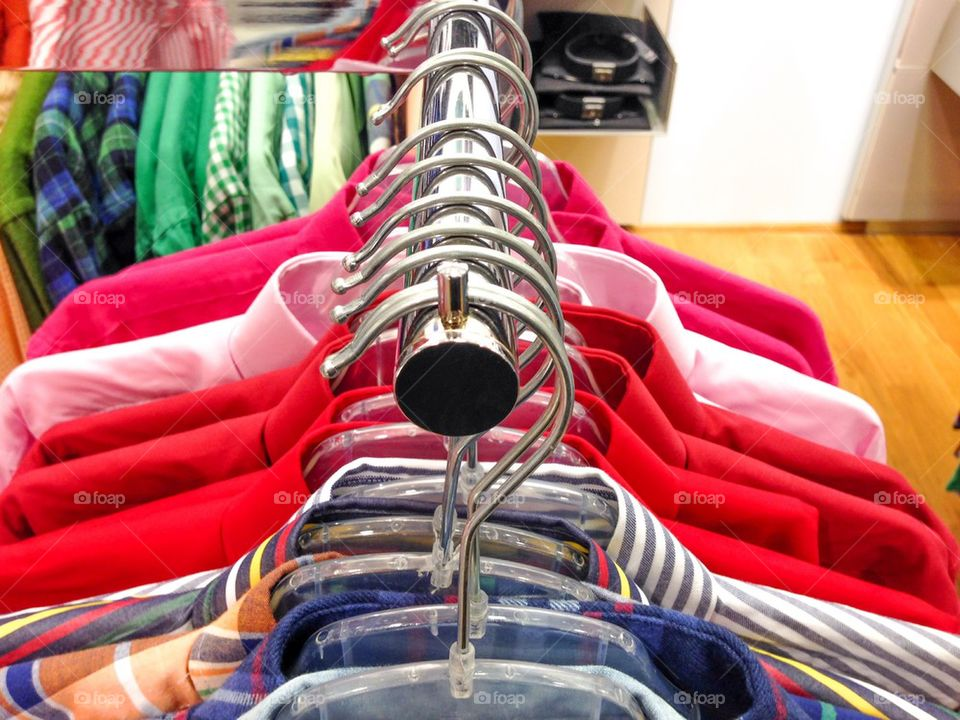 Close-up of shirts on hangers
