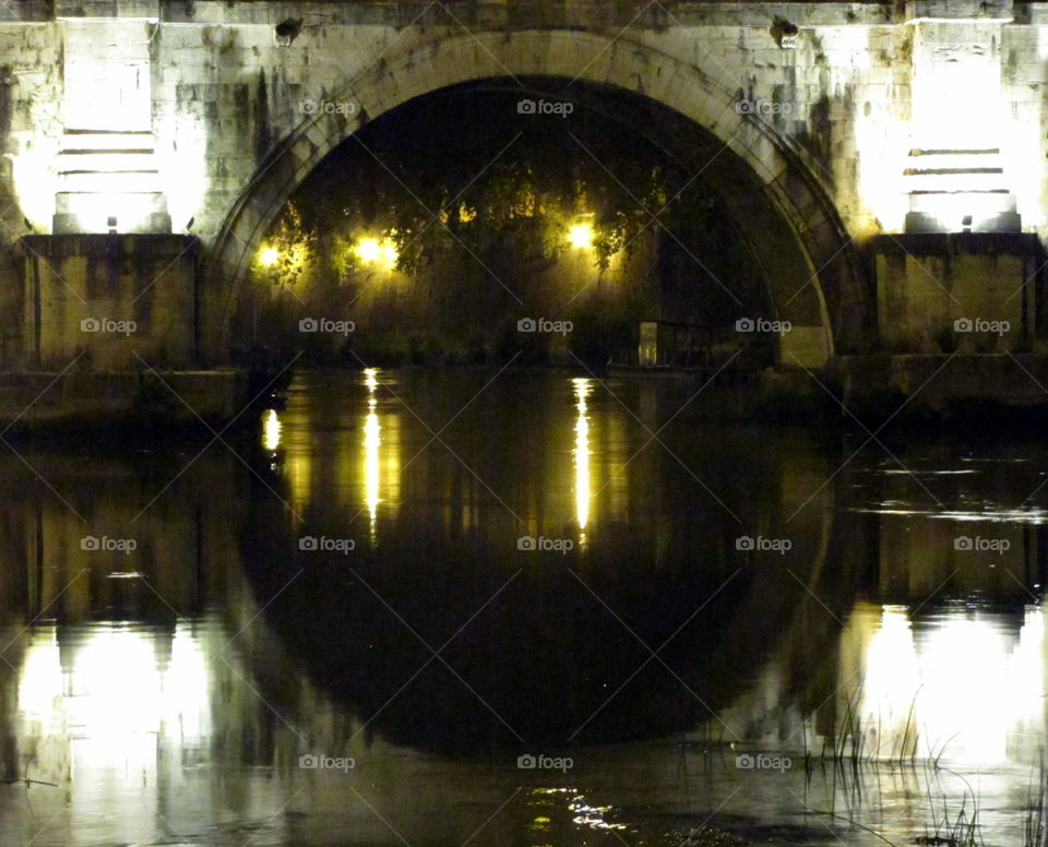 bridge over the river at night with reflection