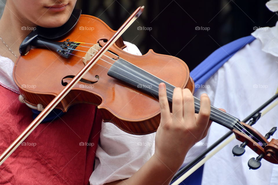 a girl plays the violin