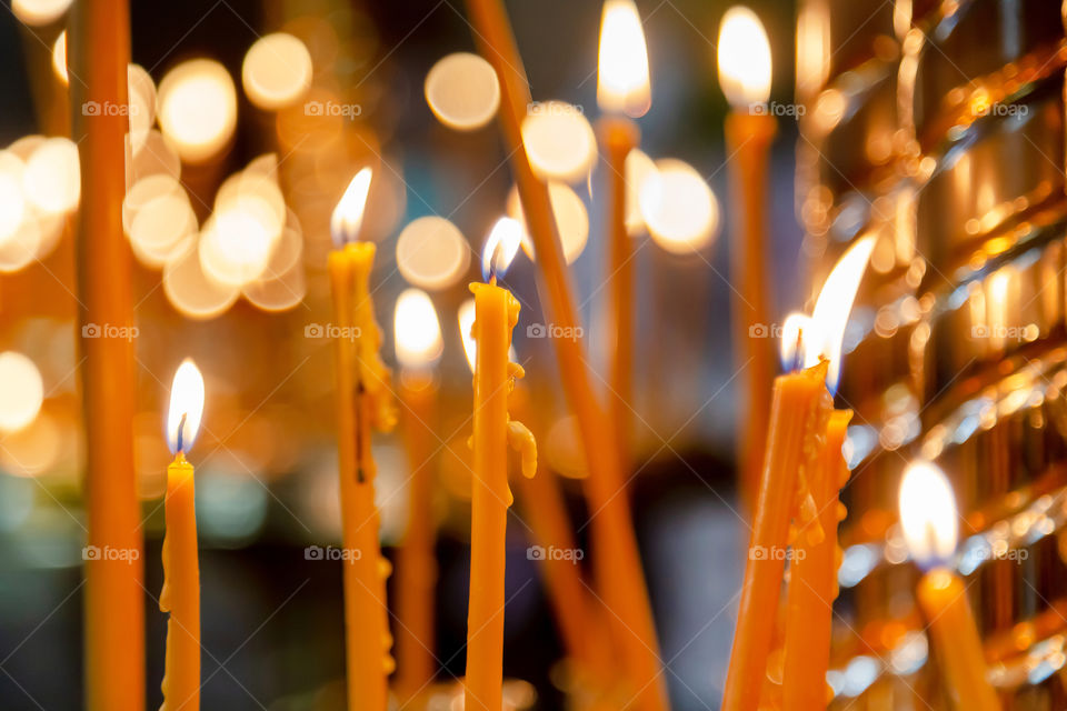 Lit up candles in the church