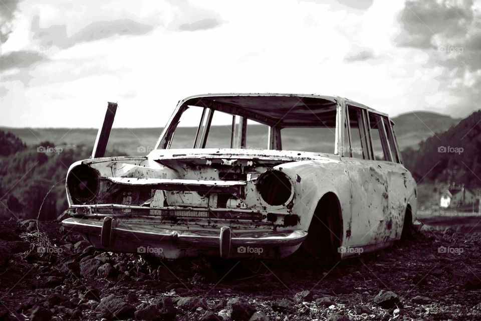Old car on road 666