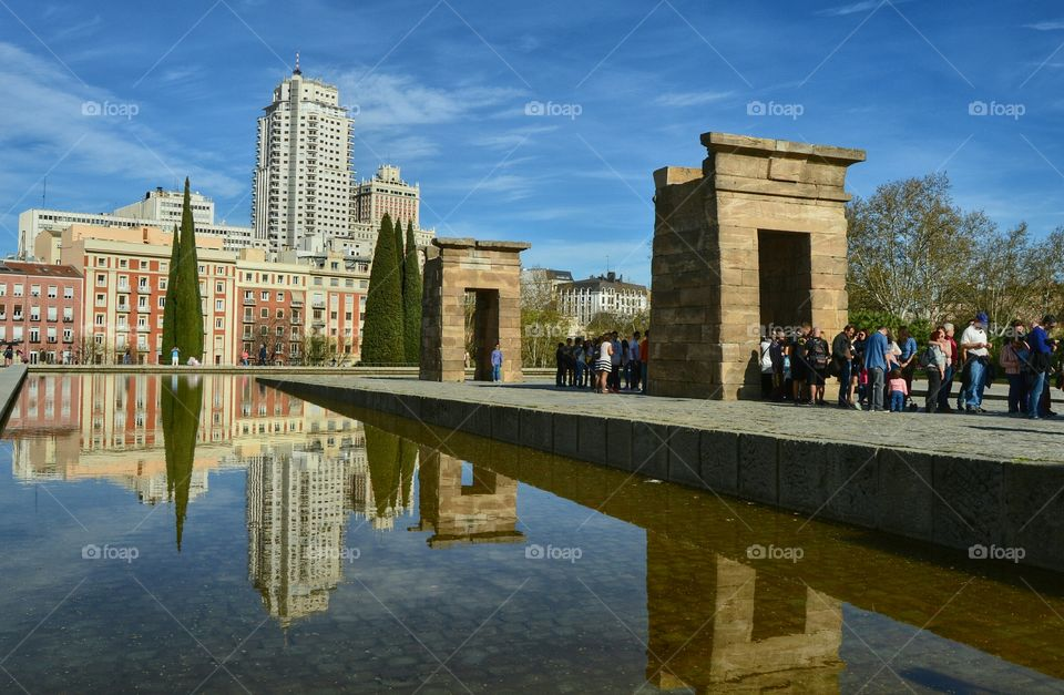 Modern vs Old. Contrast between Egyptian architecture at Temple of Debod and modern buildings at Plaza de España, Madrid