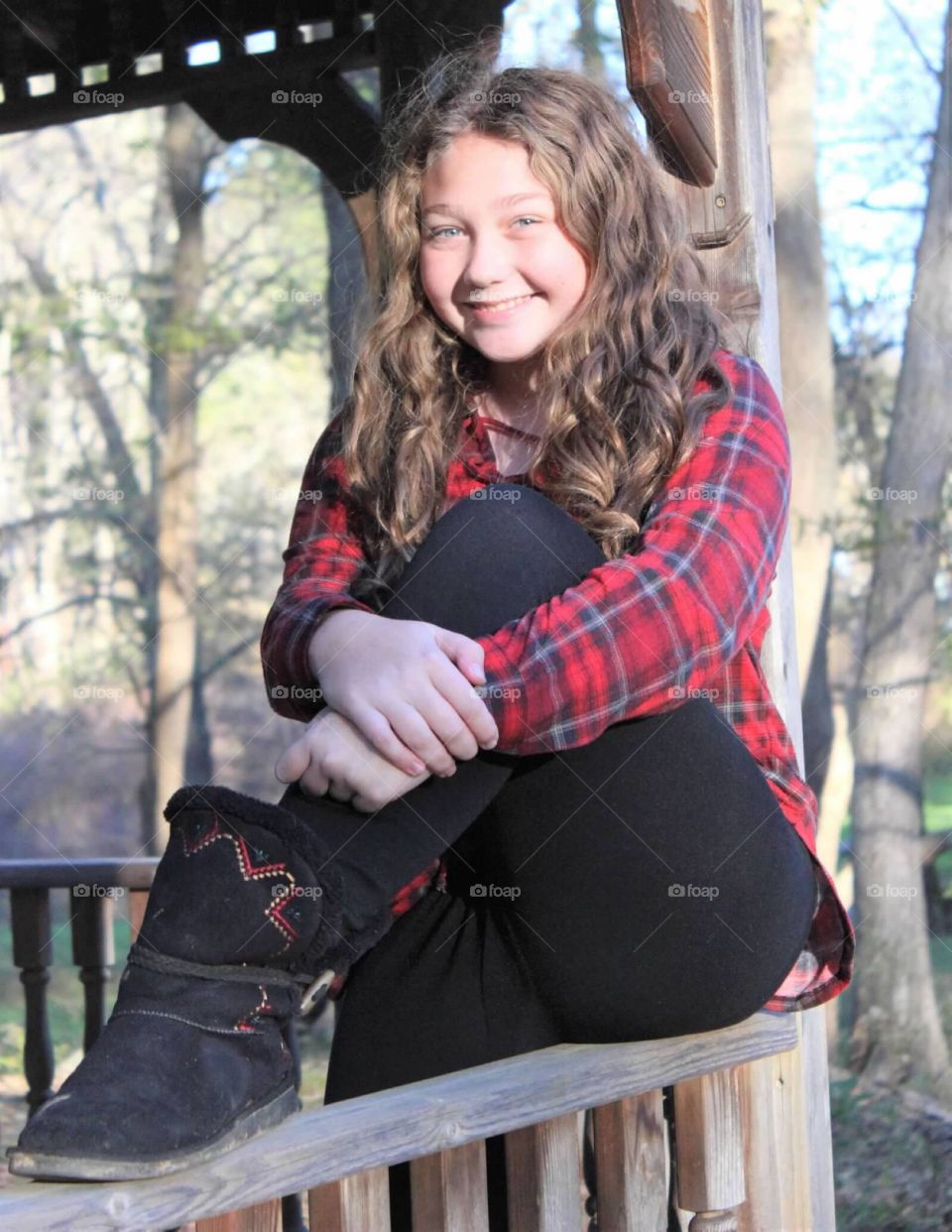 Young beautiful preteen, with a gorgeous radiating smile, posing for fall photos.