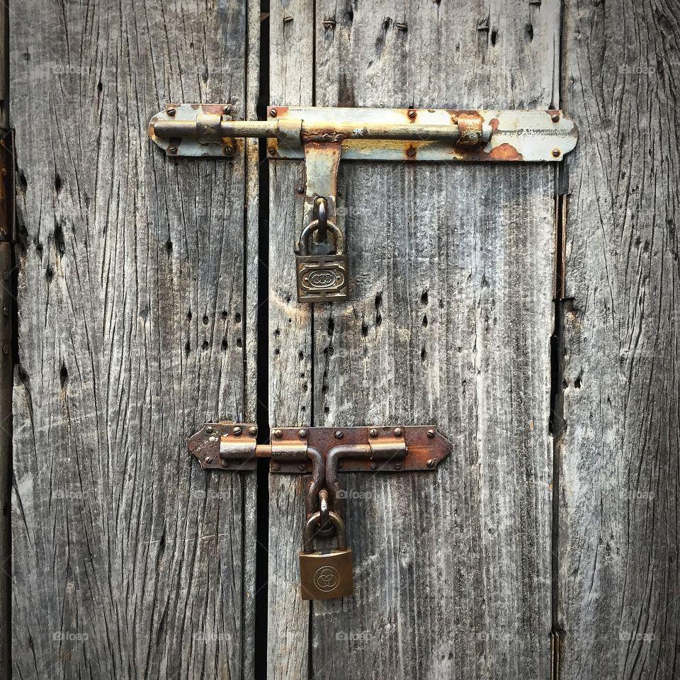 Locks and wooden door