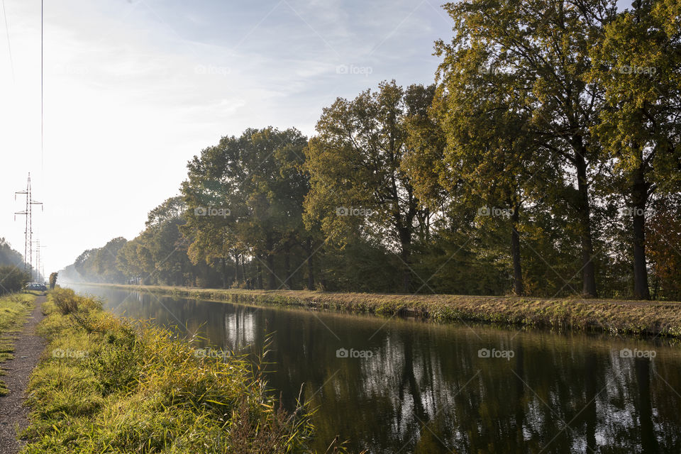 """A landscape portrait of a canal named """"de vaart"""" in Belgium, the sides of the canal are the perfect leading lines for drawing a viewer in."""