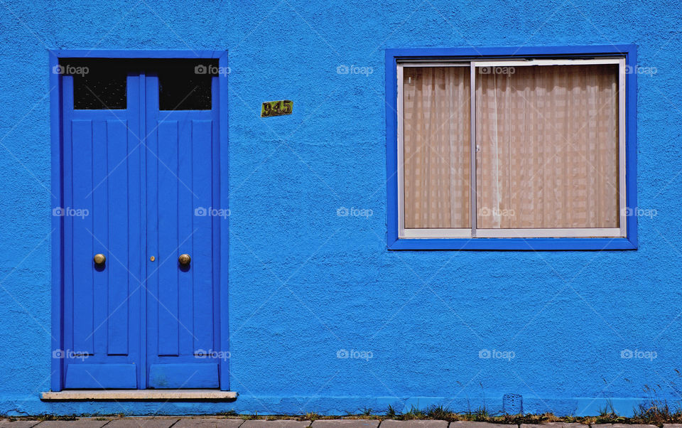 A colorful blue house in Puenta Arenas, Chile, South America