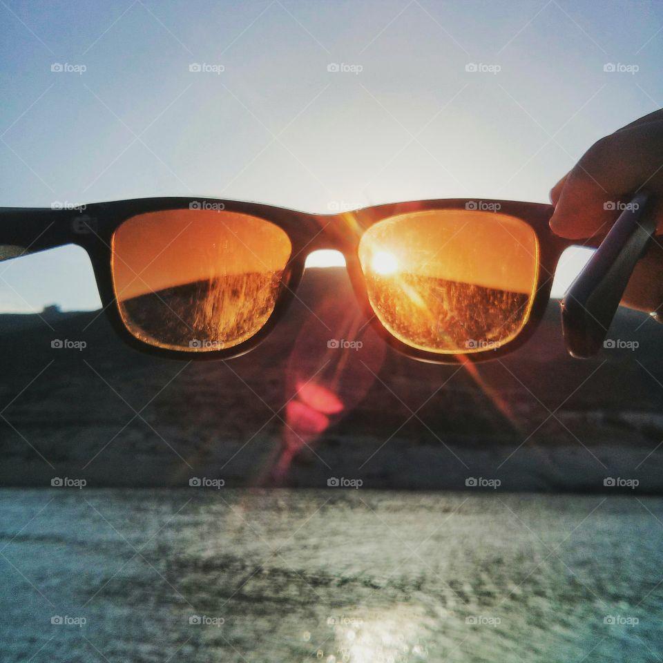 sun through glasses