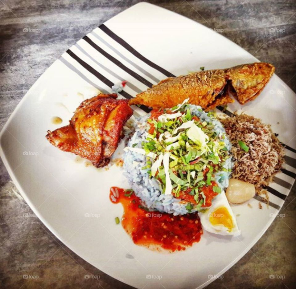Chicken meat with rice in plate