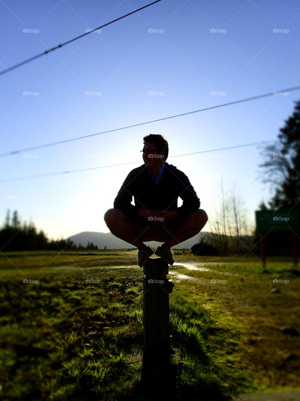 Squatting on a post