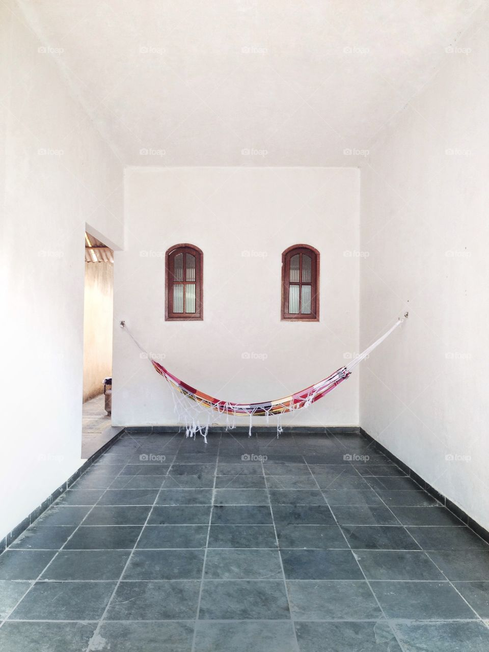 Hammock hanging in front view wall