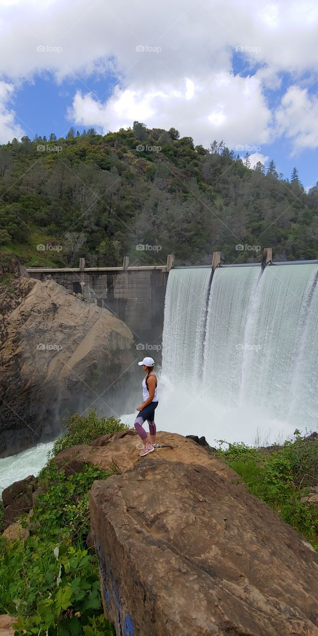 Breathtaking view of a gorgeous waterfall pool dam on Clementine trail. A must see hiking experience with family and friends on top of a mountain cliff on a Sunny day.