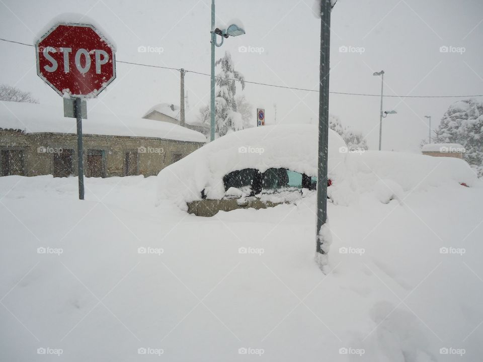 CAR covered under the snow. Big one snow in North Italy