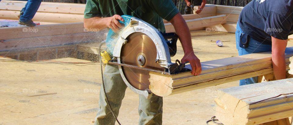 Man handling cutting machine