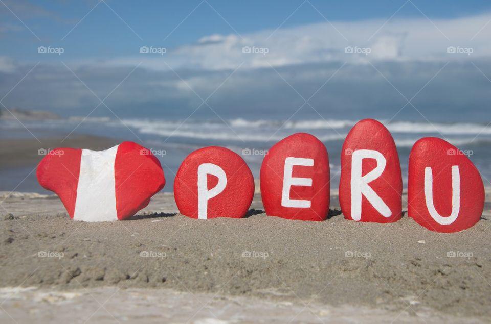 Peru, souvenir on stones with national flag
