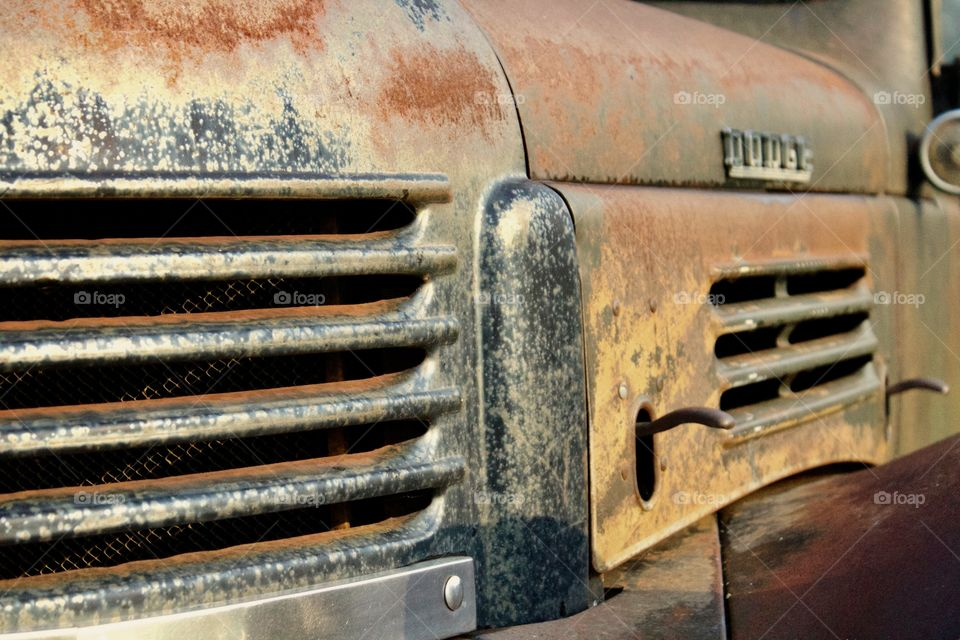 Side view of an antique truck's engine vents