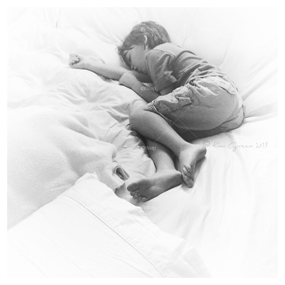 Boy Sleeping in Black and White. Young boy asleep/black and white/portrait