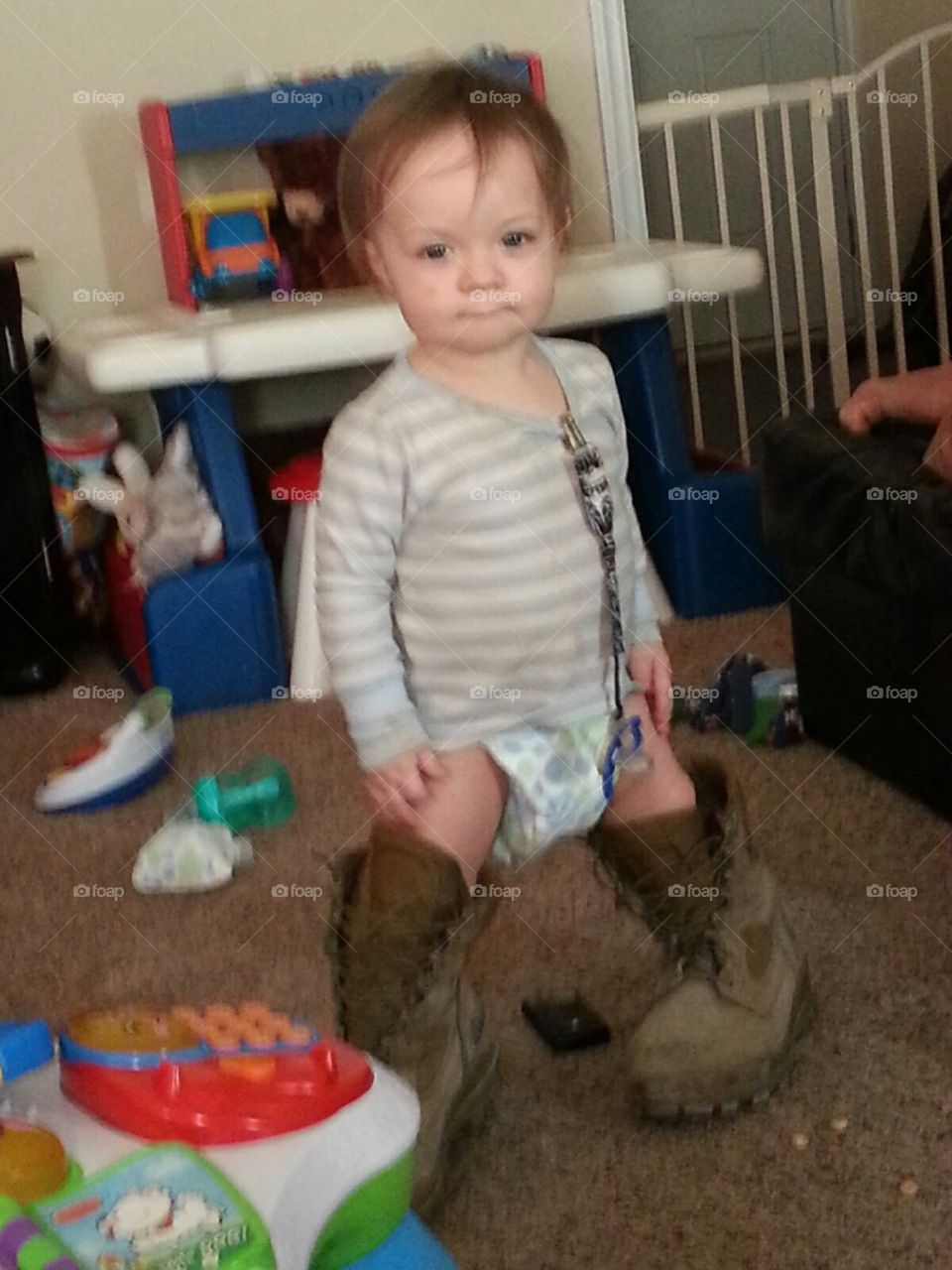 In Daddy's boots. My grandson is wearing his daddy's work boots