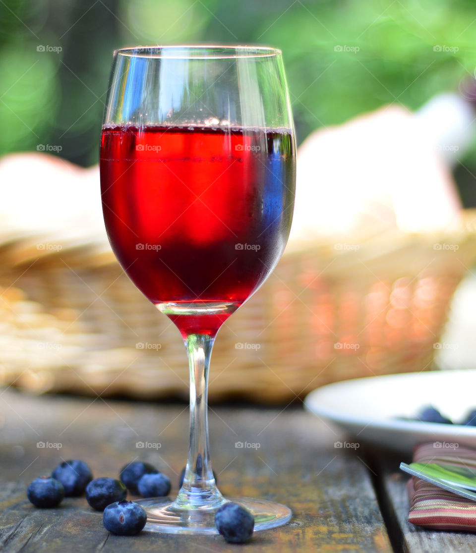 Red wine with blue berries