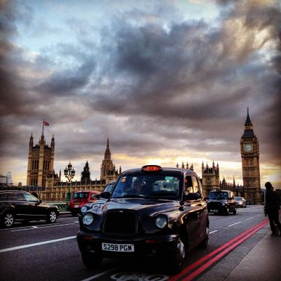 London Icons. Featuring a classic London taxi with British Parliament in the background.