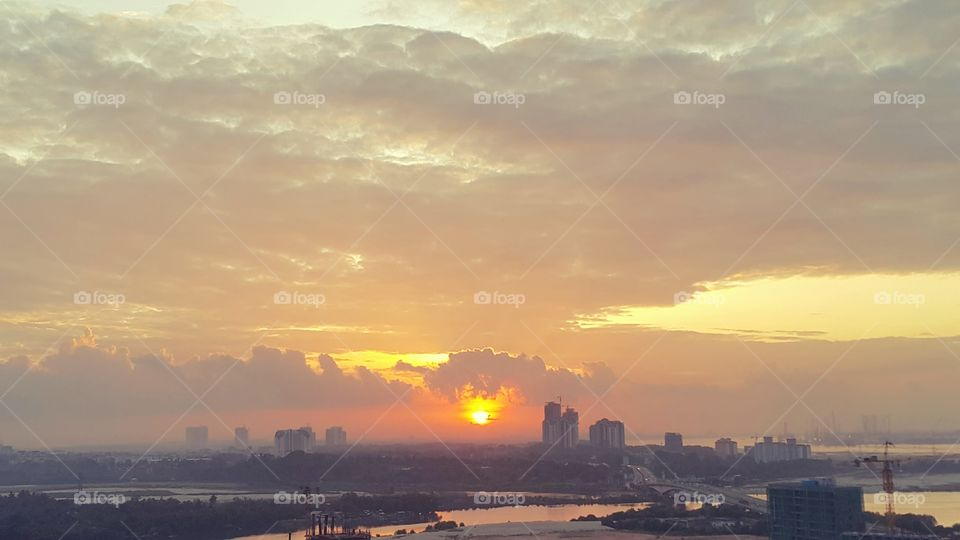 Sunrise view against cloudy sky