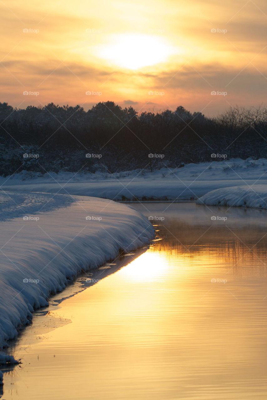 Scenic view of winter sunset