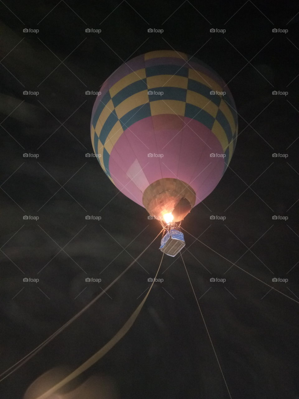 A hot air balloon is a lighter than air aircraft consisting of a bag, called an envelope, which contains heated air. Suspended beneath is a gondola or wicker basket (in some long-distance or high-altitude balloons, a capsule), which carries passengers and (usually) a source of heat, in most cases an open flame. The heated air inside the envelope makes it buoyant since it has a lower density than the colder air outside the envelope. As with all aircraft, hot air balloons cannot fly beyond the atmosphere. Unlike gas balloons, the envelope does not have to be sealed at the bottom, since the air near the bottom of the envelope is at the same pressure as the surrounding air. In modern sport balloons the envelope is generally made from nylon fabric and the inlet of the balloon (closest to the burner flame) is made from a fire resistant material such as Nomex. Modern balloons have been made in all kinds of shapes, such as rocket ships and the shapes of various commercial products, though the traditional shape is used for most non-commercial, and many commercial, applications.  The hot air balloon is the first successful human-carrying flight technology. The first untethered manned hot air balloon flight was performed by Jean-François Pilâtre de Rozierand François Laurent d'Arlandes on November 21, 1783, in Paris, France,[1] in a balloon created by the Montgolfier brothers.[2] The first hot-air balloon flown in the Americas was launched from the Walnut Street Jail in Philadelphia on January 9, 1793 by the French aeronaut Jean Pierre Blanchard.[3] Hot air balloons that can be propelled through the air rather than simply drifting with the wind are known as thermal airships. A hot air balloon is a lighter than air aircraft consisting of a bag, called an envelope, which contains heated air. Suspended beneath is a gondola or wicker basket (in some long-distance or high-altitude balloons, a capsule), which carries passengers and (usually) a source of heat, in most cases an open..