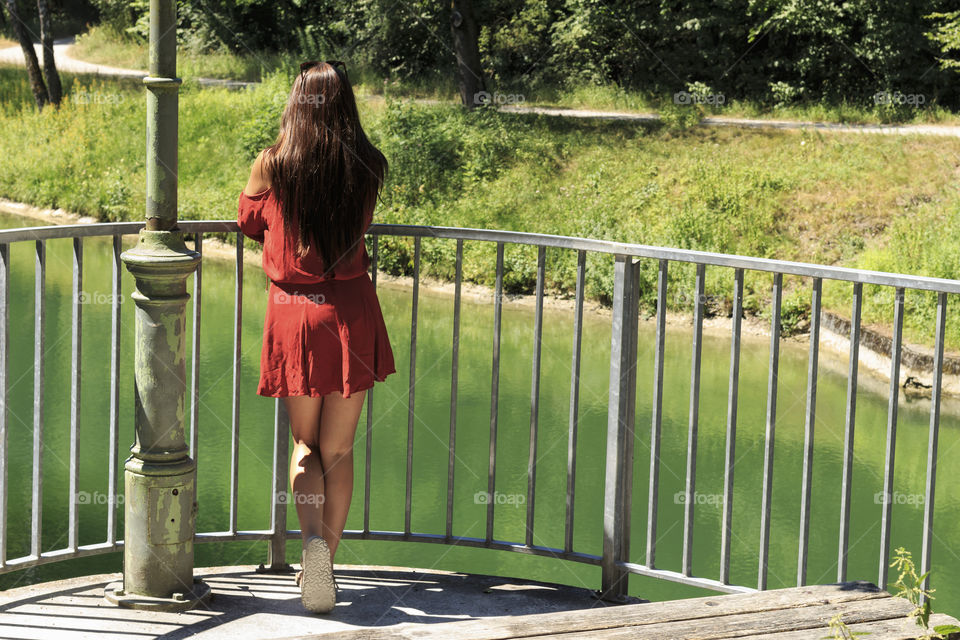 Girl looks over railing